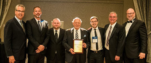 The Winston Heat Treating team accepting the Commercial Heat Treater of the Year award